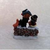 Miniatur Schneemann am Baum